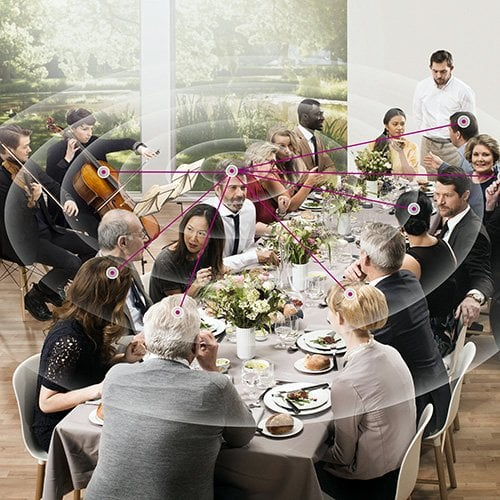 people in dining room with graphic overlaid representing unfocused hearing